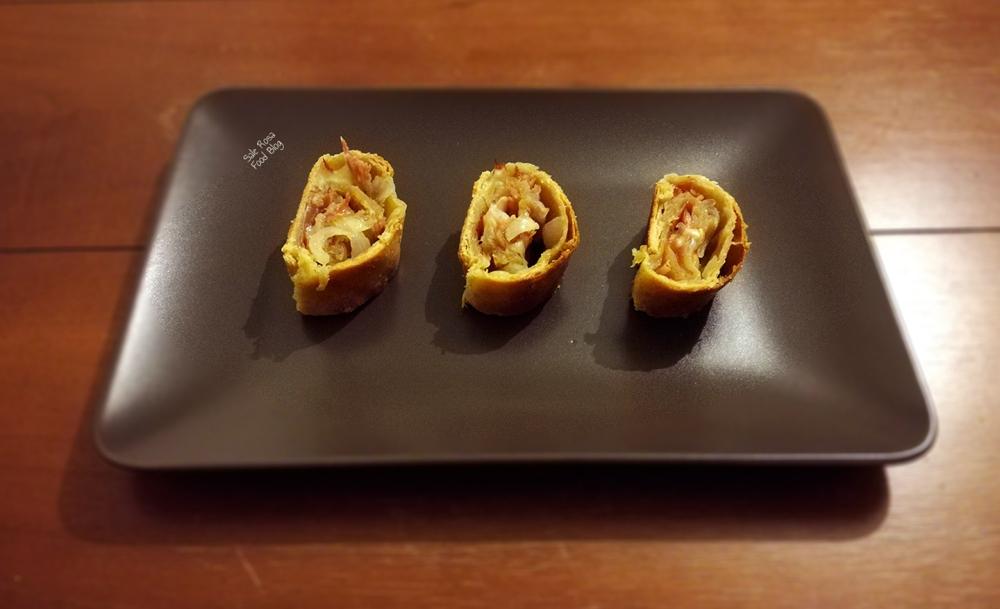 Strudel salato con cipolla, speck e scamorza affumicata